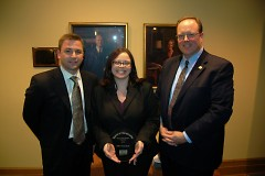 "Fifth Third Bank employees, including Volunteer Coordinator Jamie Martinez (center), accept their ""Above & Beyond"" award."