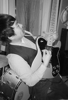 Dan Fisher playing guitar