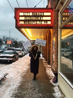 Community member Jasmyne Fuentes outside the theater before the forum raising awareness on issues.