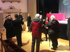 Residents and press question the City Manager candidates after the forum.