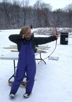 Aeris Shillington learns about archery at last year's Winterfest.