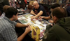 Players try a game at the exhibition hall before purchasing.