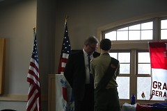 Alex Putkovich presents Michael Putkovich with his Eagle Scout Mentor Pin