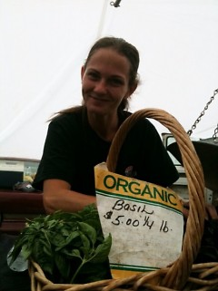 Amanda DeVries (daughter of Farmers' Rose & James) with her basil at the Fulton Market.