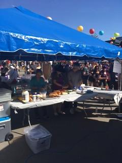 Vendors prepare sandwiches at the Asian Festival on Saturday, June 10, 2017.