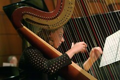 Grand Rapids Symphony Principal Harpist Elizabeth Colpean plays an important role in the performance of John Williams' score.