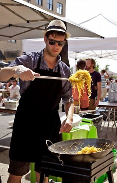 Tory O'Haire making ramen at Local First Street party, 2014
