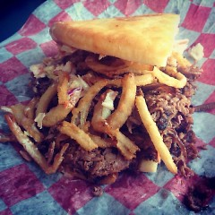Brisket with bbq sauce, cole slaw and haystack onions.