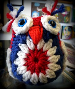 Tiny owl made from scraps of yarn