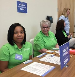 "Staffers Candice and Cindy are ready at their ""health clinic"" table to help participants."