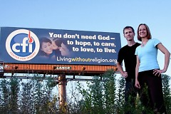 Co-Directors Jefferson Seaver and Jennifer Beahan in front of the CFI sponsored billboard from September 2011