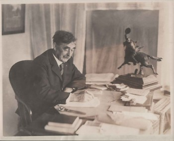 Charles E. Belknap (October 17, 1846 – January 16, 1929) writing at his desk. He was a United States congressman in the House of
