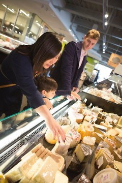 Shoppers check out the cheese at the Downtown Market