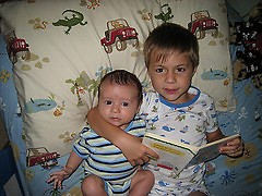 Reading to toddlers and infants early can really help children with language development.