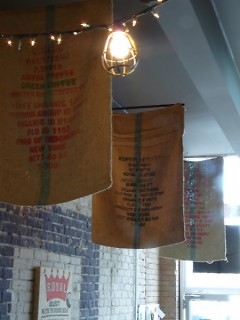Coffee bags hanging from the ceiling. All coffee comes from Grand Rapids Coffee Roasters.
