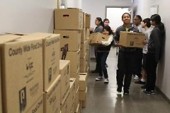 Volunteers at the County Wide Food Campaign help organize food donations for families in need.