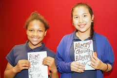 Two young authors hold the latest anthology of youth writing from the Creative Youth Center