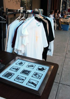 Prints and screen printed shirts at the Avenue for the Arts Market
