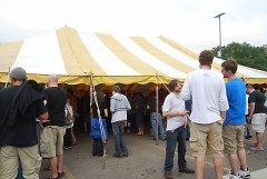 Wood-Aged Beer Festival attendees stand outside the beer tent
