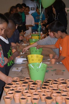 Amway sponsors St. Patrick's Day event including planting shamrocks for good luck.