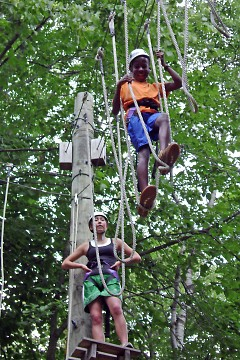 Campers carefully cross the high ropes course located at Camp O'Malley.
