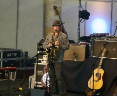 Andy Goessling plays two saxophones simultaneously.