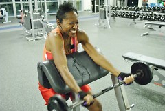 Leah Thomas uses a barbell to work on her biceps at the Kroc Center.