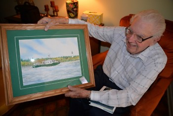 Howard Tanner shows off a painting of the Research Vessel Tanner.