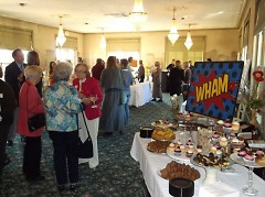 Attendees socializing with each other for Wham event.