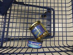 Left behind: When cashing out, I had to leave my beloved olives and a can of tuna behind. Suddenly, these were luxury items.
