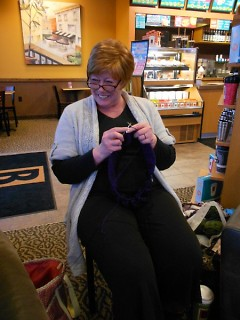 Naughty Knitter Vicki takes a break from her project to joke around with the group.