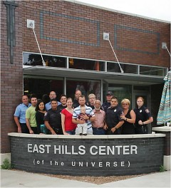 "Members of East Hills Council of Neighbors photographed in front of the ""Center of the Universe"" building"