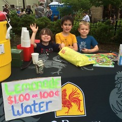 Children selling lemonade at Eat. Shop. Rock. 2015