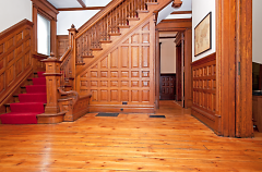 Entryway with butler bench on left