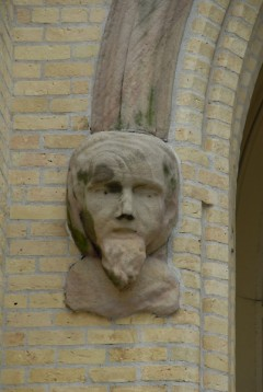 Face on the entranceway at St. James Catholic Church on Bridge Street NW, perhaps one of the city's earliest public art pieces