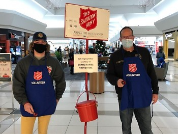 Father-son team of Jeff and Drew VanderWall ringing at Macy's.