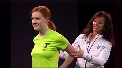 Theresa Rupinksi and Teri Harmon demonstrate simple partner exercises.