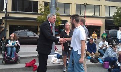 Sam Long and Shawn Feldt shake hands with Mayor George Heartwell.  Cindy Rhodes ETS looks on from behind.