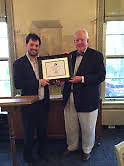 Garret Ellison (L) was presented with the 2015 Baxter Award by Grand Rapids Historical Society Trustee Tom Dilley.