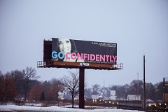 """One of the GOCONFIDENTLY Ads. Underneath the slogan is says """"experts in botox"""""""