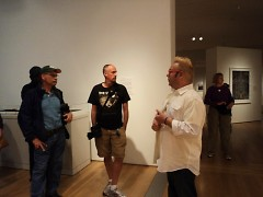 Terry Johnston addressing the group outside the Andrew Moore exhibit