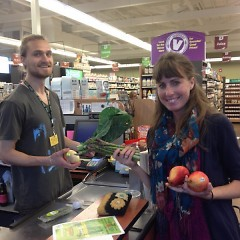 Crystal LeCoy buying produce during a recent visit to People's Food Coop of Kalamazoo
