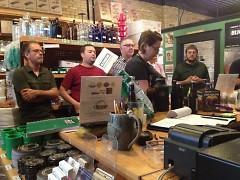 Club members listen to guest speaker Ben Darcie at July's monthly meeting