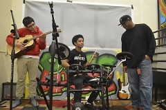 Daniel Arellano, left, and Christopher Garcia, on drums, do some jamming while deejay James Burgen offers pointers