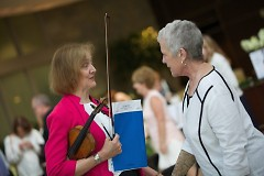 Grand Rapids Symphony's Music for Health program is administered by Diane McElfish Helle (left) s