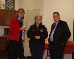 Ruth Kelly, Lynn Rabaut and Greg Sundstrom visit inside new community room