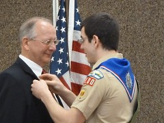 Tom Haley gives his father, Mike Haley, his Eagle Scout Mentor Pin