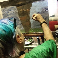 Artist Jane VanDommelen adding finishing touches on her  ArtPrize piece.