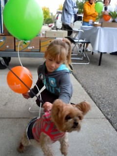 A young hiker with Chela, the Food Bank mascot.