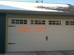Graffiti on the garage of a ICCF townhome between Wealthy & Cherry